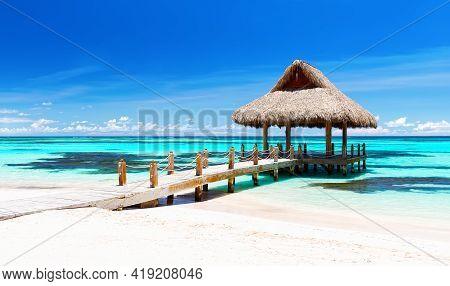 Panorama Of Beautiful Gazebo On The Tropical White Sandy Beach In Punta Cana, Dominican Republic. Va