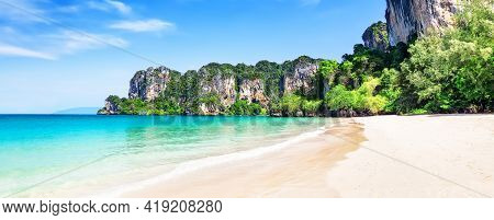 Panorama Of Thai Traditional Wooden Longtail Boat And Beautiful Sand Railay Beach In Krabi Province.