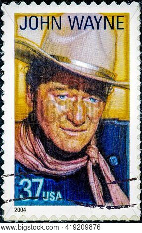 Usa - Circa 2004: A Stamp Printed In The Usa Shows John Wayne American Film Actor Director And Produ