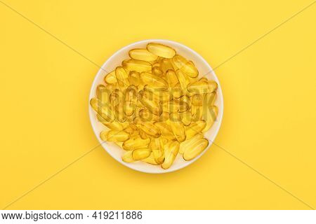 Top View Of Fish Oil Gel Capsules Isolated In White Dish On White Background. Salmon Fish Capsules V