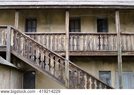 Wooden Staircase And Veranda Of Old Abandoned House
