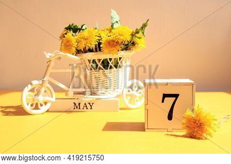Calendar For May 7 : A Cube With The Number 7, The Name Of The Month Of May In English, A Bicycle Wi