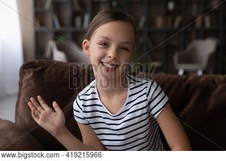Portrait Of Smiling Girl Child Talk On Webcam Call