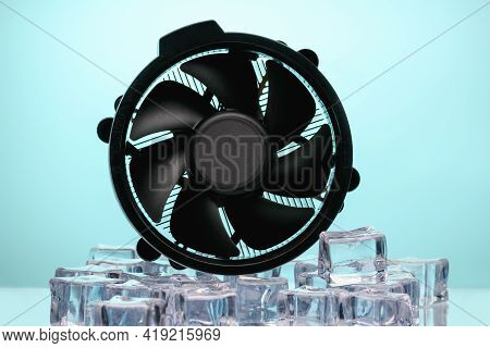 Computer Cooling Fan In Ice With Blue Backlight. Cooler Cooling Concept