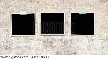 Three retro photos on old stucco wall. Vintage blank photo frames. Mock up template. Copy space for your text