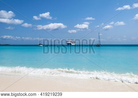 The Cruise Ship And Two Yachts Are Drifting Near Half Moon Cay Island Beach (bahamas).