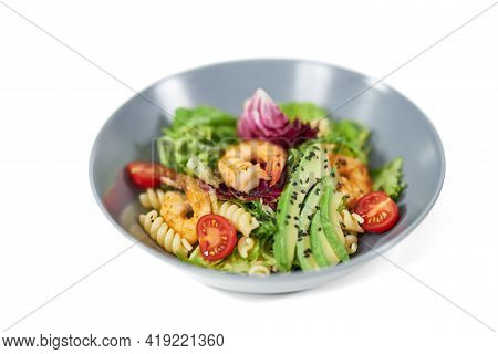 Close Up Of Modern And Beautiful Plate With Appetizing Pasta In Vegetables And With Seafood On White