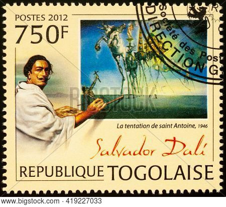 Moscow, Russia - May 03, 2021: Stamp Printed In Togo Shows Spanish Artist Salvador Dali (1904-1989)