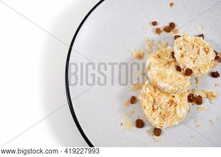 Top View Close Up Of Three Appetizing Dietary Sweet Cheesecakes Sprinkled With Raisins And Nuts On W