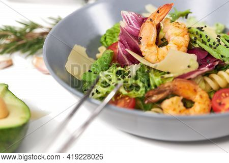 Close Up Of Tasty And Juicy Pasta With Seafood And Fresh Herbs On White Background. Concept Of Appet