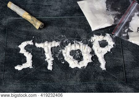 Line Of White Powder Drugs, Cocaine, Speed And Plastic Bags With Other Drugs, Stop Written In The Po