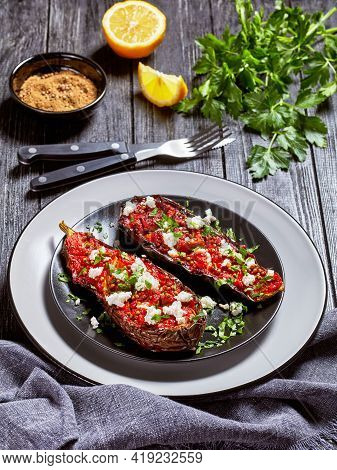 Eggplants Stuffed With Savory Tomatoes, Onions And Spices And Topped With Crumbled Feta On A Plate O