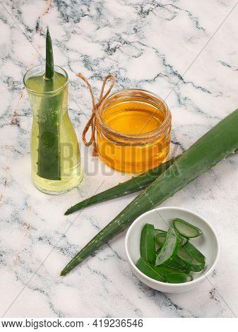 Aloe Vera And Honey Closeup On Light Marble Background. Sliced Aloe Vera Natural Organic Renewal Cos