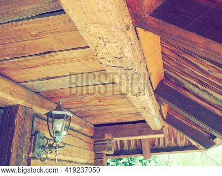 Woodworking For Construction And Roofing. Wooden Beam And Roof In A Traditional Peasant House. Metal