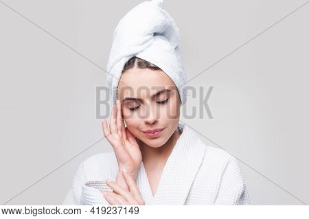 Sensual Girl Applying Moisturizing Cream On Her Face. Photo Of Young Girl With Flawless Skin. Skinca