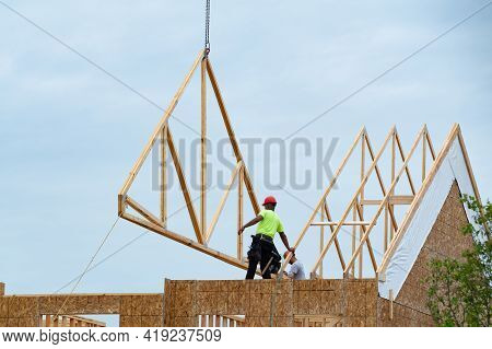 Installation Of Rafters On A New Plywood House