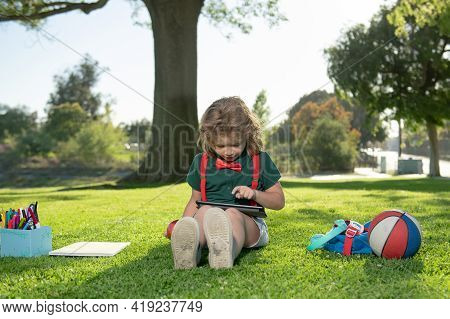 Nerd Pupil. Little Child Learning Outdoor By Studying Online And Working On Tablet In Green Field.