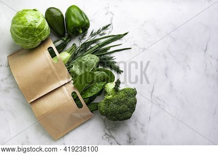 Fresh Natural Green Vegetables In Paper Bags: Lettuce, Cucumbers, Zucchini, Green Onions And Dill, N