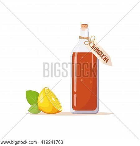 Glass Bottle Of Kombucha Tea, Label With An Inscription, Next To Juicy Lemon And Green Mint Leaves.