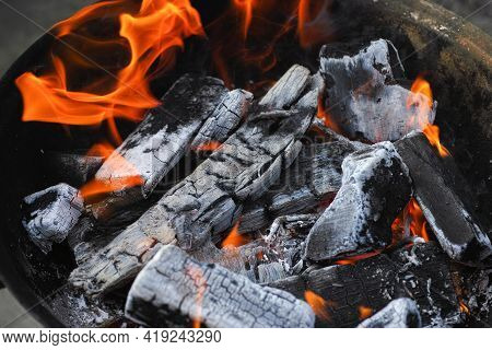 Burning Charcoal Inside A Grill. Close Up.