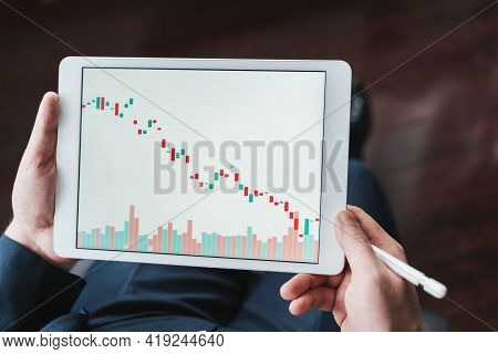 Businessman, Investor,trader Analyzing,looking At Chart Of Stock Prices In Tablet. Ceo,general Manag