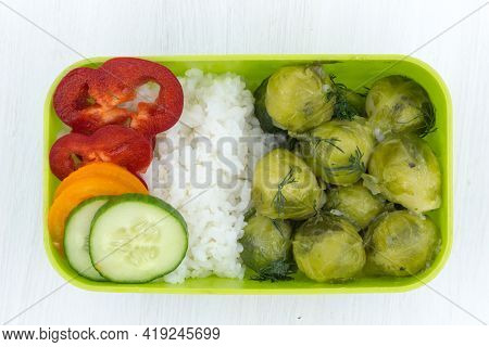 Home-cooked Lunch Of Rice And Brussels Sprouts, Lunch At Work, Vegetarian Food In The Lunchbox.