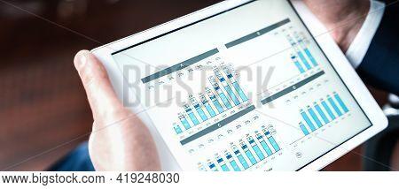 Working Businessman,investor,trader.financial Report,presenatation In Tablet.diagram,gantt Chart, An