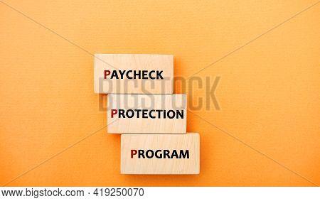 Wooden Blocks With Words Paycheck Protection Program. Loan That Helps Businesses Keep Their Workforc