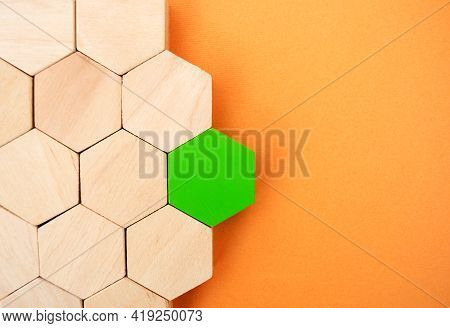 One Green Hexagon Stands Out From The Rest. Leadership And Victory Concept. Dissimilarity And Dissen