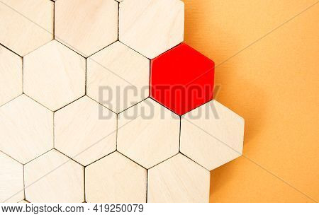 One Red Hexagon Stands Out From The Rest. Leadership And Victory Concept. Dissimilarity And Dissent.