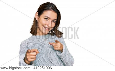 Young caucasian girl wearing casual clothes pointing fingers to camera with happy and funny face. good energy and vibes.
