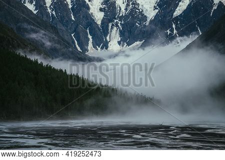 Atmospheric Landscape With Great Snowy Mountain Wall And Dense Low Clouds Among Forest Silhouettes I