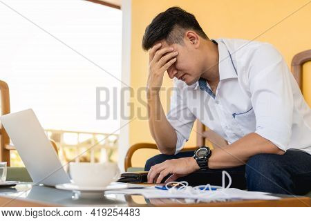 Desperate And Stressed Businessman Is Working With Laptop Computer.