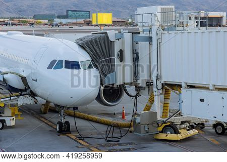 Aircraft At Boarding Bridge Jetway Connected To The Airplane For Boarding Passengers