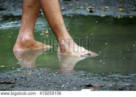 Image Of Kid Bare Foot With Muddy Feet After Rain.