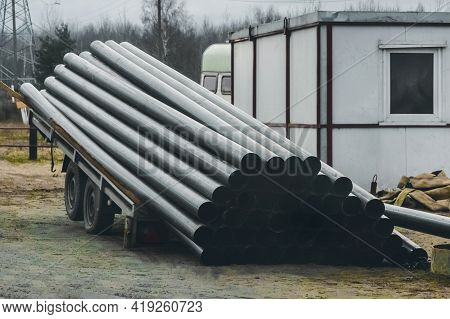 A Pile Of Polyethylene Pipes Industrial Materials Loaded And Storage Outdoor At A Construction Site.