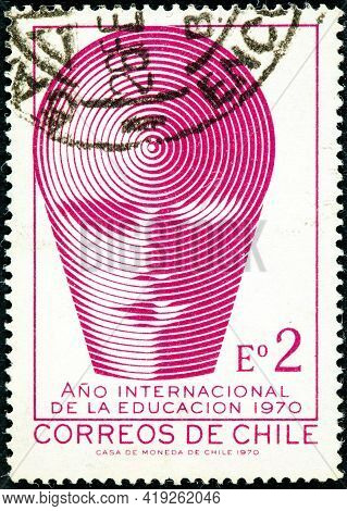 Chile - Circa 1970: A Stamp Printed In The Chile Shows Emblem Of International Education Year In Chi