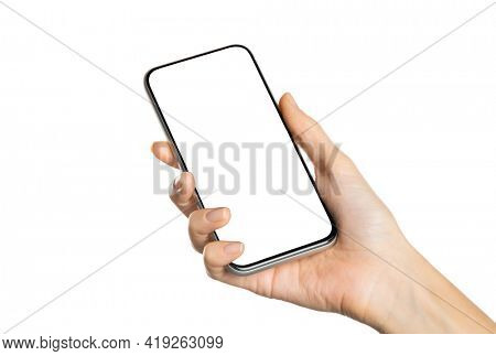 Close up of female hand holding smartphone device and showing empty blank screen isolated on white. Woman hand using app on smart phone on white background. Holding mobile phone with empty screen.