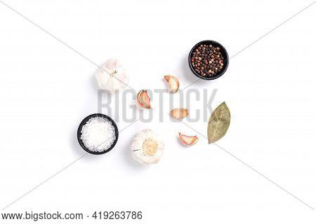 Set Of Spicy Garlic, Salt, Pepper, Bayleaf On White Background. Top View