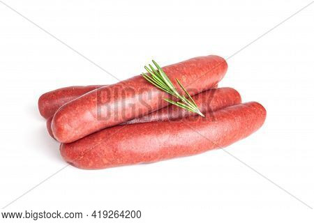 Raw Meat Beef Sausages For Grill And Spicy, Herbs Rosemary, Pepper, Salt On White Background. Food B