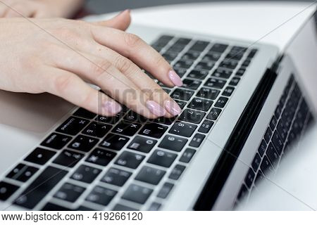 Female Office Worker Typing On The Keyboard, Working At Home Office Hand On Keyboard Close Up. High
