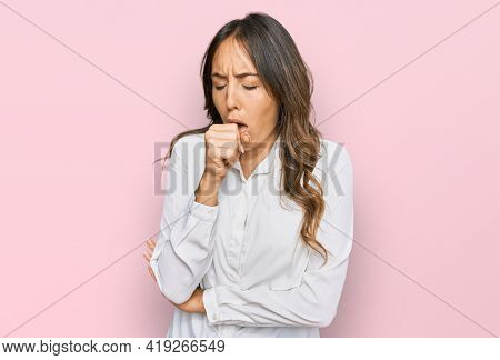 Young brunette woman wearing casual clothes feeling unwell and coughing as symptom for cold or bronchitis. health care concept.
