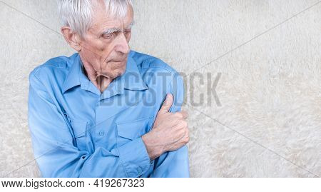 Male Hand Holding Forearm. Eldery Man Suffering From Pain In Hand. Bone Disease.  White Background.