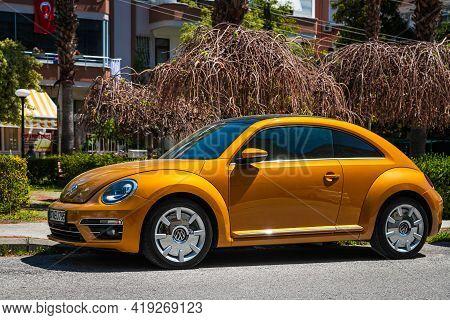 Alanya, Turkey - April 17 2021: Vintage  Orange Car Volkswagen Beetle On The Background Of A City St