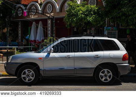 Alanya, Turkey - April 17 2021:  Silver Hyundai Santa Fe Classic Is Parked  On The Street On A Warm