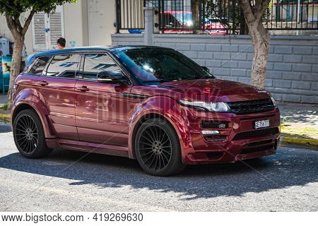Alanya, Turkey - April 17 2021:  Red Range Rover Evoque   Is Parked  On The Street On A Warm Summer