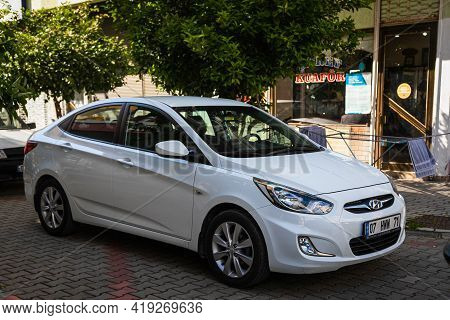 Alanya, Turkey - April 17 2021:  White Hyundai Solaris   Is Parked  On The Street On A Warm Summer D