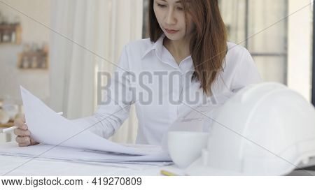 Architect Engineer Design Working, Female Architect Working At Home, Concept Blueprints.