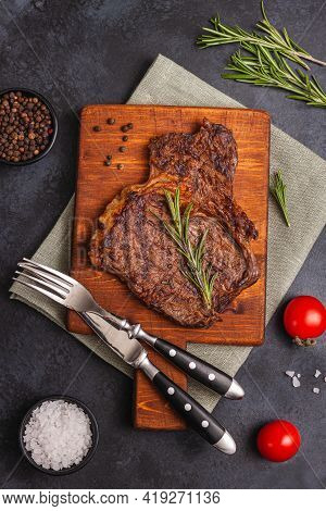 Grilled Beef Steak With Spices And Herbs On Wooden Board. Top View Flat Lay With Copy Space