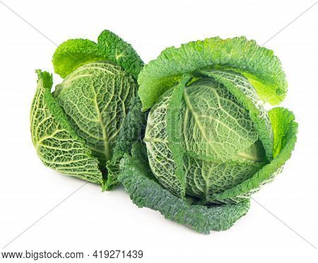 Whole Head Of Savoy Cabbage Over White Background.